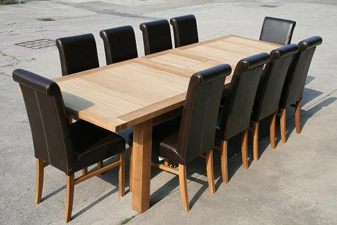 2.4 - 2.9m Tallinn extending table with luxury dark brown Emperor leather chairs with roll back.  Table �699, chairs �79 each at our oakdiningsets website