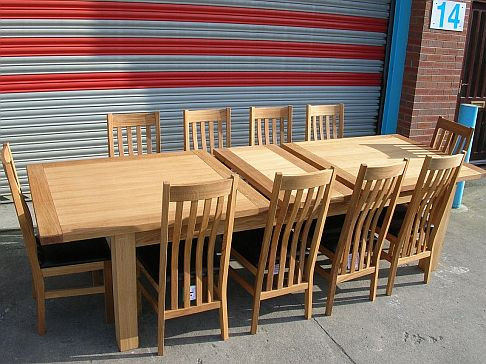 2.4 - 2.9m Tallinn butterfly extending table with Winchester leather chairs.  Table �699, chairs �85 each